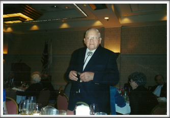 Herman Littman at the Banquet, Lucy Littman sitting at right