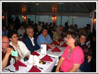 "Dinner on the ""Majestic"" Riverboat:  Ellsworth Family - Bill and Elodie Caldwell, Reid Ellsworth, Janet Ellsworth, Diane Hill, Barbara Richins, Helen and Roy Chappell, other Kriegies and families"