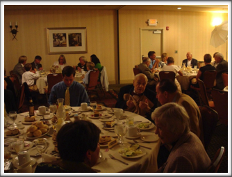 "Banquet - Tim Christmann, ""Doc"" DiFrancesco, Bob O'Neill, Jeanne Boyd, Maria Christmann, Other Kriegies and Families"
