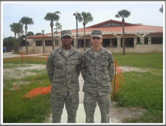 "MacDill AFB - Tour Guides Airman Ellis and Airman Shelby in front of the ""Mess"" hall."