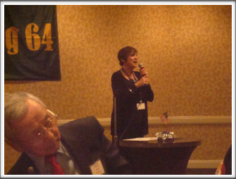 Arlene Rosenthal at the banquet announcing our guest speaker and author, John Loftus (Jimmie Kanaya on the left)