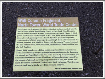 Sign displayed next to a 5-ton piece of steel from one of the twin towers