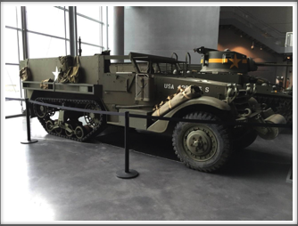 "An M-3 half-track like the one used by Abe Baum during the ""Raid"" ordered by General George Patton.  Displayed at the US Freedom Pavilion/Boeing Center"