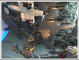 Some of the WWII aircraft displayed near the ceiling of the US Freedom Pavilion/Boeing Center at the WWII Museum