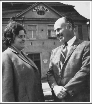 Amon Carter Jr. and Eugenia Grecka in front of the Szubin train station where she worked and shared war news with Amon by leaving messages in a wastebasket