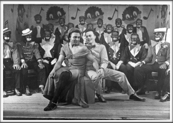 "November '43 -Glee Club,  ""The Robert E. Lee Minstrels"", Leo Farber as ""Queenie"", Russell Ford and Glee Club members - top row l-r: R. Crawford, H. Korger, J. Fraser, S. Stetson, J. Carpenter, Johnson; middle row l-r: Davis, D. Waful, Jones, Carlson, S. Bolten; front row l-r: T. Cipriani, B. Fabian, T. Holt, C. Willis, H. Holder, C. Campbell, F. Maxwell, S. Thal, W. Sharpe"