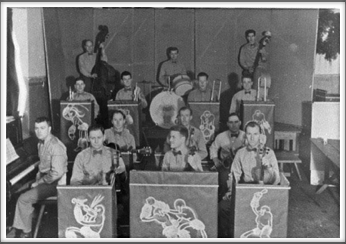 August '43 - The Orchestra Top row l-r: J. Barker, K. Goddard, R. Lobb, Third row l-r: B. Rankin, T. Holt, D. Waful, R. Chappell, Second row l-r: G. Oughton, G. Lucey, I. Yarock, First row l-r: Piano-T. A. Mitchell, J. Friedman, L. Wilcox, T. Pawloski