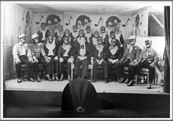 "November '43 - Glee Club, ""The Robert E. Lee Minstrels"", Front Row l-r:  T. Cipriani, B. Fabian, T. Holt, K. Willis, H. Holder, C. Campbell, F. Maxwell, S. Thal, W. Sharpe. Second and Third Rows: Other members of the Glee Club"