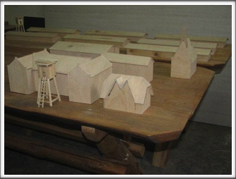 Close-up view of Oflag 64 building models in the carpentry shop