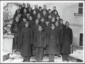 TEXANS - Front l-r:  Col. Doyle Yardley, Col. Charles Jones; 2nd row, 2nd from left behind the Kriegy with the mustache is John R. Rodgers; 2nd row, far right is Roy J. Chappell; 3rd row, 1st on left is Michael Calpin; 2nd from left is Amon Carter; 3rd from left is Harry E. Evans; 4th row, 2nd from left is Leonard W. Spence