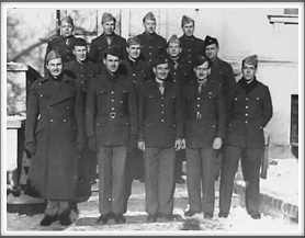 Front l-r: Horace Spaulding, William Kleysteuber, Robert P. Milligan, Clyde Herring, Bruce Martin; 2nd Row l-r: Robert Eckman, Lumund Wilcox, John Kamps, Donald Wilkinson; Back l-r:  Kenneth Johnson, Charles L. Jones, Harry Carlson, Bernard Bolton  (Photo courtesy of Iowa Gold Star Military Museum on Camp Dodge, Johnston, Iowa)