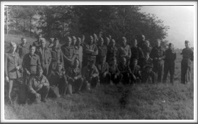Unknown date, Oflag 64 group photo taken just outside of camp.  (left view)