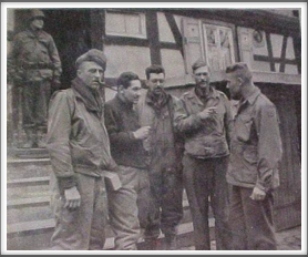 Lt. Col. James W. Lockett, 4th from left, speaking to Capt. Louis Torgeson after escaping from a German prison at Hammelburg, Germany - 4/3/45