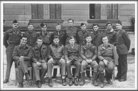 Repatriation Center  1/12/45 - POWs from Oflag 64 back row far left: Nathaniel R. Hoskot, 2nd from left: Myrick L. Monroe, 4th from left:  Lt. Laurence B. Higgins, far right: Frank Maxwell